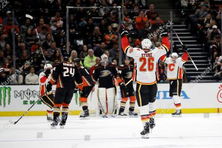 Calgary Flames' Michael Stone (26) celebrates after scoring against the Anaheim Ducks during the second period of an NHL hockey game, in Anaheim, Calif