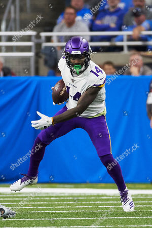 Minnesota Vikings wide receiver Stefon Diggs (14) runs the ball against the Detroit Lions during an NFL football game in Detroit