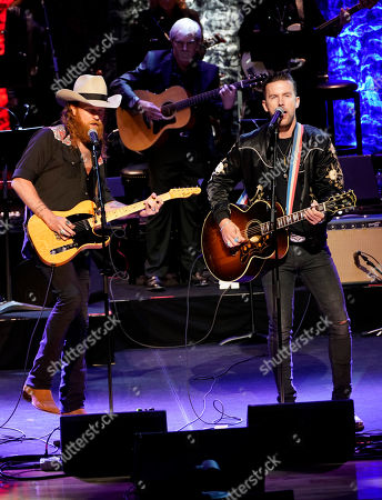 Stock Image of T.J. Osborne,John Osborne. T.J. Osborne and John Osborne, of Brothers Osborne, perform during the 2019 Medallion Ceremony at the Country Music Hall of Fame and Museum on in Nashville, Tenn