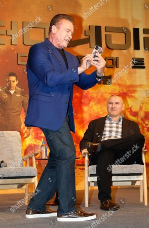 Arnold Schwarzenegger (L) reacts next to US director Tim Miller (R) during a media event for the movie 'Terminator: Dark Fate' in Seoul, South Korea, 21 October 2019. The movie will open in South Korea's theaters on 30 October 2019.