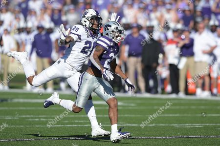 TCU Horned Frogs safety Vernon Scott (26) makes sure the officials see that he didn't interfere with the pass intended for Kansas State Wildcats wide receiver Wykeen Gill (21) during the NCAA Football Game between the TCU Horned Frogs and the Kansas State Wildcats at Bill Snyder Family Stadium in Manhattan, Kansas
