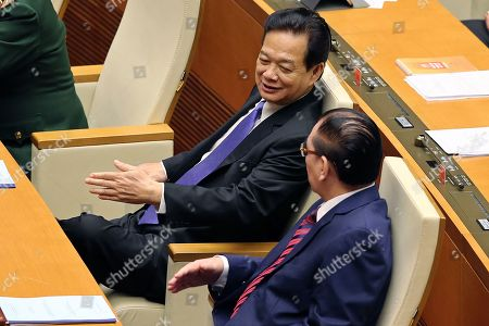 Vietnam's former Party General Secretary Nong Duc Manh (R) and Vietnam's former Prime Minister Nguyen Tan Dung (L) the opening of the eighth session of the National Assembly's 14th tenure in Hanoi, Vietnam, 21 October 2019.