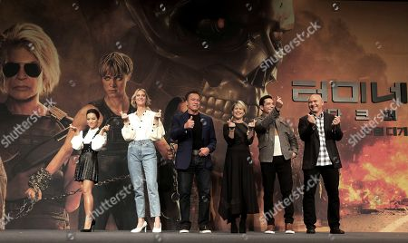 Natalia Reyes, Mackenzie Davis, Arnold Schwarzenegger, Linda Hamilton, Gabriel Luna, Tim Miller pose. From left; actress Natalia Reyes, actress Mackenzie Davis, actor Arnold Schwarzenegger, actress Linda Hamilton, actor Gabriel Luna and director Tim Miller pose during a press conference to promote their latest movie 'Terminator: Dark Fate' in Seoul, South Korea, . The movie is to be released in South Korea on Oct. 30