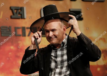 Director Tim Miller wears the South Korean traditional hat during a press conference to promote his latest movie 'Terminator: Dark Fate' in Seoul, South Korea, . The movie is to be released in South Korea on Oct. 30