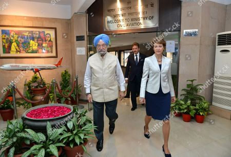 Vice President of the Swiss Federal Council, Simonetta Sommaruga (R), and Indian Civil Aviation Minister Hardeep Singh Puri (R), walk around the Ministry of Civil Aviation building in New Delhi, India, 21 October 2019. Sommaruga is on an official visit to India from 18 to 21 October 2019.