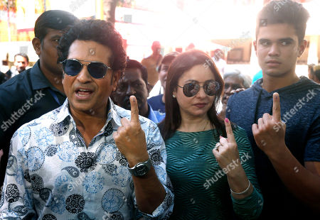 Former Indian cricketer Sachin Tendulkar, left, with his wife Anjali and son Arjun pose for media after casting their votes in Mumbai, India, . Voting is underway in two Indian states of Maharashtra in the west and Haryana in the north where the Hindu nationalist Bharatiya Janata Party (BJP) headed by prime minister Narendra Modi is trying to win a second consecutive term