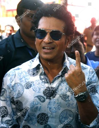 Former Indian cricketer Sachin Tendulkar poses for media after casting his votes in Mumbai, India, . Voting is underway in two Indian states of Maharashtra in the west and Haryana in the north where the Hindu nationalist Bharatiya Janata Party (BJP) headed by prime minister Narendra Modi is trying to win a second consecutive term