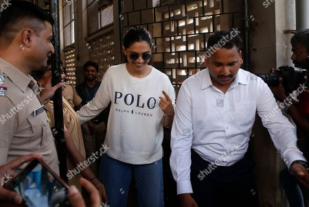 Bollywood actress Deepika Padukone, center, shows indelible ink mark on her index finger after casting her vote outside a polling station in Mumbai, . Polling is being held to elect Indian states of Maharashtra and Haryana assemblies with the ruling Bharatiya Janata Party and its allies seeking to retain power in the two states on the back of the recent general elections victory