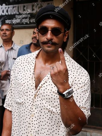 Bollywood actor Ranveer Singh shows indelible ink mark on his index finger after casting his vote outside a polling station in Mumbai, . Polling is being held to elect Indian states of Maharashtra and Haryana assemblies with the ruling Bharatiya Janata Party and its allies seeking to retain power in the two states on the back of the recent general elections victory