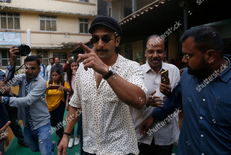 Stock Photo of Bollywood actor Ranveer Singh shows indelible ink mark on his index finger after casting his vote outside a polling station in Mumbai, . Polling is being held to elect Indian states of Maharashtra and Haryana assemblies with the ruling Bharatiya Janata Party and its allies seeking to retain power in the two states on the back of the recent general elections victory