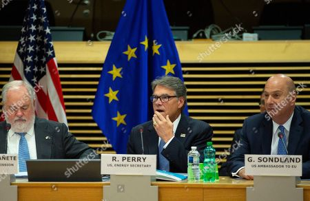 Stock Image of United States Secretary of Energy Rick Perry, left, U.S. Ambassador to the EU Gordon Sondland, right, and European Commissioner for Energy Miguel Arias Canete, left, attend the High Level Forum on Small Modular Reactors at EU headquarters in Brussels