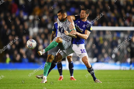 Lukas Jutkiewicz of Birmingham City battles with Bradley Johnson of Blackburn Rovers.