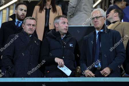 Neil Harris (ex Millwall manager - centre)  & Mick McCarthy (Republic of Ireland Manager - R) watch the game