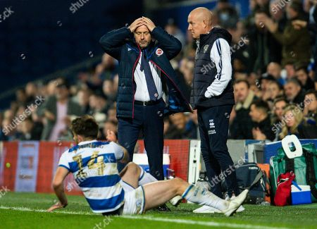 Mark Bowen manager of Reading reacts with Ryan Manning of QPR and Mark Warburton manager of QPR also seen