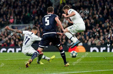 Erik Lamela of Tottenham Hotspur strikes the ball under Jan Vertonghen to score Tottenham Hotspur?s fourth goal
