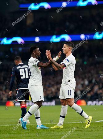 Erik Lamela of Tottenham Hotspur celebrates scoring Tottenham Hotspur?s fourth goal of the night with Serge Aurier of Tottenham Hotspur