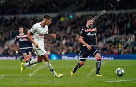 Erik Lamela of Tottenham Hotspur strikes the ball toward goal