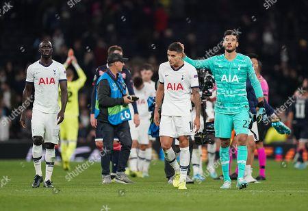 Paulo Gazzaniga of Tottenham Hotspur pats goalscorer  Erik Lamela of Tottenham Hotspur on the head at the full time whistle