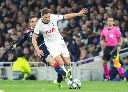Jan Vertonghen of Tottenham Hotspur is challenged by Tomane of Red Star Belgrade