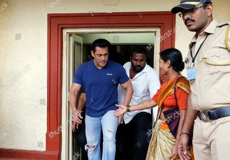 Indian Bollywood actor Salman Khan looks at his fan as he comes out after casting his vote in Mumbai, India, . Voting is underway in two Indian states of Maharashtra in the west and Haryana in the north where the Hindu nationalist Bharatiya Janata Party (BJP) headed by prime minister Narendra Modi is trying to win a second consecutive term