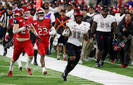 UNLV tight end Noah Bean heads for a long gain against Fresno State during the first half of an NCAA college football game in Fresno, Calif