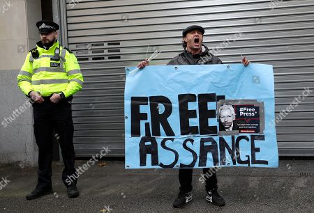 Supporters of Wikileaks founder Julian Assange demonstrate oustide Westminster Magistrates' Court in London where Assange is expected to appear as he fights extradition to the United States on charges of conspiring to hack into a Pentagon computer, in London, . U.S. authorities accuse Assange of scheming with former Army intelligence analyst Chelsea Manning to break a password for a classified government computer