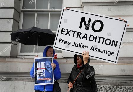 Supporters of Wikileaks founder Julian Assange demonstrate oustside Westminster Magistrates' Court in London where Assange is expected to appear as he fights extradition to the United States on charges of conspiring to hack into a Pentagon computer, in London, . U.S. authorities accuse Assange of scheming with former Army intelligence analyst Chelsea Manning to break a password for a classified government computer