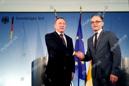 Belarusian Foreign Minister Vladimir Makei (L) and German Foreign Minister Heiko Maas shake hands after a joint press conference at the German Federal Foreign Office in Berlin, Germany, 21 October 2019. Foreign Minister Makei met the German counterpart in the German capital and had a conversation on bilateral issues.