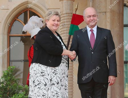Stock Photo of Barham Salih, Erna Solberg. Iraqi President Barham Salih, right, shakes hands with visiting Norwegian Prime minister, Erna Solberg, at Salam Palace in Baghdad, Iraq, . The Norwegian Prime minister was expected to meet with Iraq's president, prime minister and foreign minister to discuss regional security, bilateral relations, and oil investments