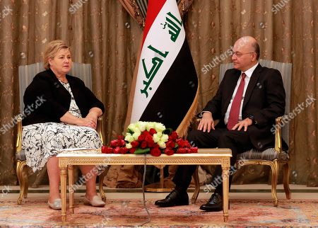 Barham Salih, Erna Solberg. Iraqi President Barham Salih, right, meets with visiting Norwegian Prime Minister, Erna Solberg, at Salam Palace in Baghdad, Iraq, . The Norwegian prime minister was expected to meet with Iraq's president, prime minister and foreign minister to discuss regional security, bilateral relations, and oil investments