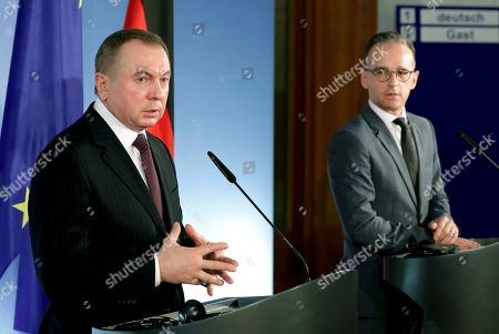 German Foreign Minister Heiko Maas, right, and the Foreign Minister of Belaruss, Vladimir Makei, left, address the media during a joint press conference after a meeting in Berlin, Germany