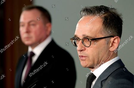 Stock Image of German Foreign Minister Heiko Maas, right, and the Foreign Minister of Belaruss, Vladimir Makei, left, address the media during a joint press conference after a meeting in Berlin, Germany