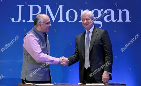 India J.P Morgan. Jamie Dimon, right, Chairman and CEO of J.P Morgan Chase, shakes hands with Junaid Ahmad, World Bank country director for India, after signing an agreement on in New Delhi, India. J.P Morgan has committed US$10 million to the World Bank for scaling up school to work transition in India