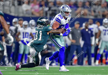 th, .Dallas Cowboys tight end Jason Witten (82) catches a pass for a first down as Philadelphia Eagles cornerback Jalen Mills (31) defends during an NFL football game between the Philadelphia Eagles and Dallas Cowboys at AT&T Stadium in Arlington, Texas