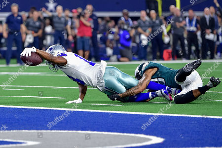 th, .Dallas Cowboys wide receiver Randall Cobb (18) catches a pass and is dragged down by Philadelphia Eagles cornerback Orlando Scandrick (38) to the 1 yard line during an NFL football game between the Philadelphia Eagles and Dallas Cowboys at AT&T Stadium in Arlington, Texas