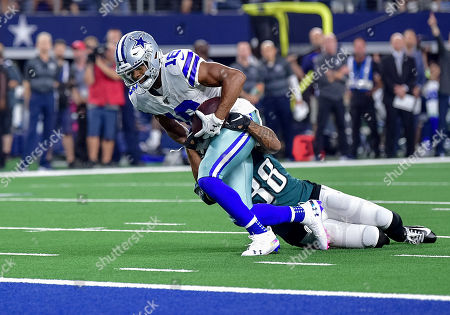 Stock Picture of th, .Dallas Cowboys wide receiver Randall Cobb (18) catches a pass and is dragged down by Philadelphia Eagles cornerback Orlando Scandrick (38) to the 1 yard line during an NFL football game between the Philadelphia Eagles and Dallas Cowboys at AT&T Stadium in Arlington, Texas