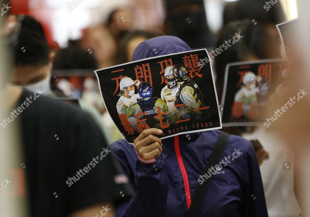 Protesters hold up posters during a rally in Tseung Kwan O MTR station marking the third month anniversary of the Yuen Long attack on 21 July 2019 where alleged triads members attack protesters and residents indiscriminately in Hong Kong, China, 21 October 2019. Hong Kong has witnessed several months of ongoing mass protests, originally triggered by a now withdrawn extradition bill to mainland China that have turned into a wider pro-democracy movement.