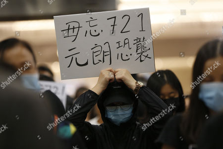 A protester holds up a placard that reads Ôdo not forget July 21sr Yuen Long attackÕ during a rally in Tseung Kwan O MTR station marking the third month anniversary of the Yuen Long attack on 21 July 2019 where alleged triads members attack protesters and residents indiscriminately in Hong Kong, China, 21 October 2019. Hong Kong has witnessed several months of ongoing mass protests, originally triggered by a now withdrawn extradition bill to mainland China that have turned into a wider pro-democracy movement.