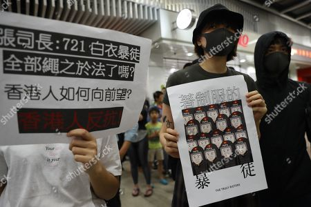 Stock Picture of Protesters hold up posters during a rally in Tseung Kwan O MTR station marking the third month anniversary of the Yuen Long attack on 21 July 2019 where alleged triads members attack protesters and residents indiscriminately in Hong Kong, China, 21 October 2019. Hong Kong has witnessed several months of ongoing mass protests, originally triggered by a now withdrawn extradition bill to mainland China that have turned into a wider pro-democracy movement.