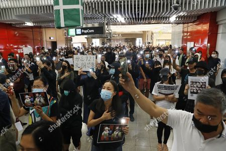 Protesters hold up their mobile phone lights during a rally in Tseung Kwan O MTR station marking the third month anniversary of the Yuen Long attack on 21 July 2019 where alleged triads members attack protesters and residents indiscriminately in Hong Kong, China, 21 October 2019. Hong Kong has witnessed several months of ongoing mass protests, originally triggered by a now withdrawn extradition bill to mainland China that have turned into a wider pro-democracy movement.