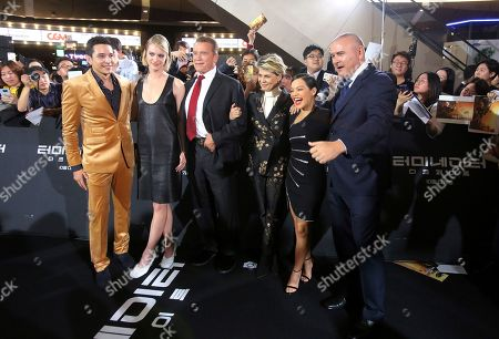 From left, actor Gabriel Luna, actress Mackenzie Davis, actor Arnold Schwarzenegger, actress Linda Hamilton, actress Natalia Reyes and director Tim Miller pose during the premiere of their latest movie 'Terminator: Dark Fate' in Seoul, South Korea, . The movie is to be released in South Korea on Oct. 30