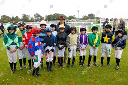 Bob Champion with the Shetland Pony Race riders before the race named in his honour at Plumpton.