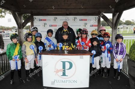 Claude Duval presents to the pony riders after the Bob Champion Cancer Trust Shetland Pony Derby at Plumpton won by Mystic Dreamer and Alfie Daiper [centre].
