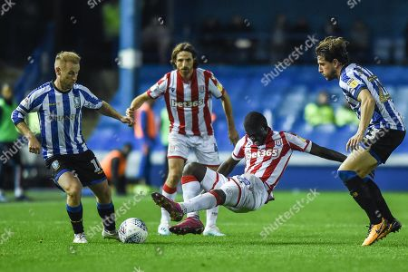 22nd October 2019, Hillsborough, Sheffield, England; Sky Bet Championship, Sheffield Wednesday v Stoke City : Badou Ndiaye (27) of Stoke City lunges into a tackle on Barry Bannan (10) of Sheffield Wednesday 
