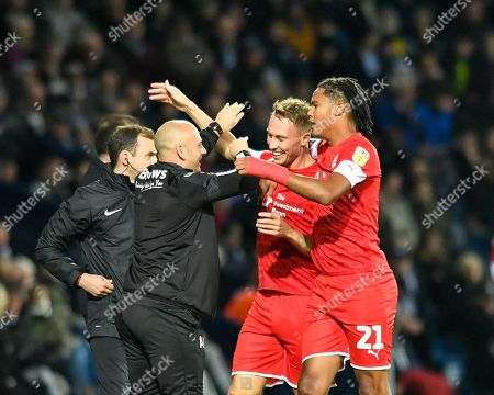 22nd October 2019, The Hawthorns, West Bromwich, England; Sky Bet Championship, West Bromwich Albion v Barnsley : Cauley Woodrow (9) of Barnsley celebrates scoring a goal with Toby Sibbick (21) and Caretaker Head Coach, Adam Murray Credit: Simon Whitehead/News Images