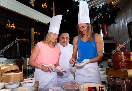 Petra Martic of Croatia and Alison Riske of the United States prepare Dim Sum ahead of the Players Party of the 2019 WTA Elite Trophy tennis tournament