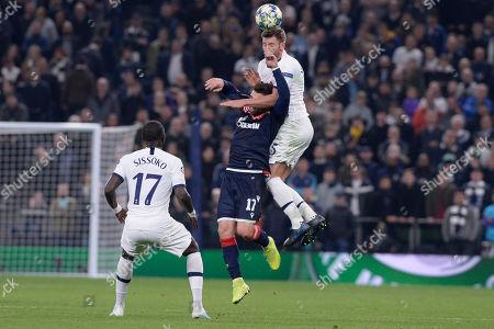 Jan Vertonghen of Tottenham Hotspur fouls Tomane of Red Star Belgrade in action during the UEFA Champions League Group B match between Tottenham Hotspur and Red Star Belgrade at The Tottenham Hotspur Stadium in London, UK - 22nd October 2019