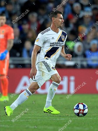 Stock Photo of LA Galaxy defender Daniel Steres passes against the Minnesota United during the first half of an MLS first-round playoff soccer match in St. Paul, Minn