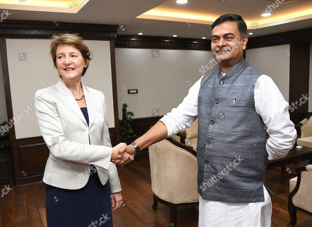 Swiss federal councillor Simonetta Sommaruga (L) shake hands with Indian Union Minister for Power and Energy R.K. Singh in New Delhi, India, 21 October 2019. Swiss Federal Councillor Simonetta Sommaruga is on her official visit to India and scheduled to meet the Indian Railway Minister and Energy Minister.