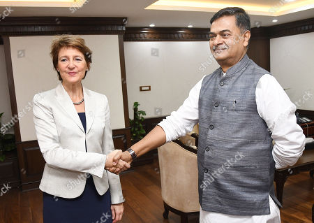 Swiss federal councillor Simonetta Sommaruga (L) shakes hands with Indian Union Minister for Power and Energy R.K. Singh in New Delhi, India, 21 October 2019. Swiss Federal Councillor Simonetta Sommaruga is on an official visit to India.